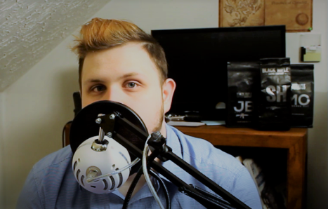 zach behind mic.PNG